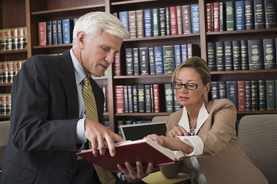 image of lawyer working with paralegal